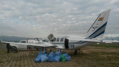 Mano a Mano plane distributing food on Sunday.