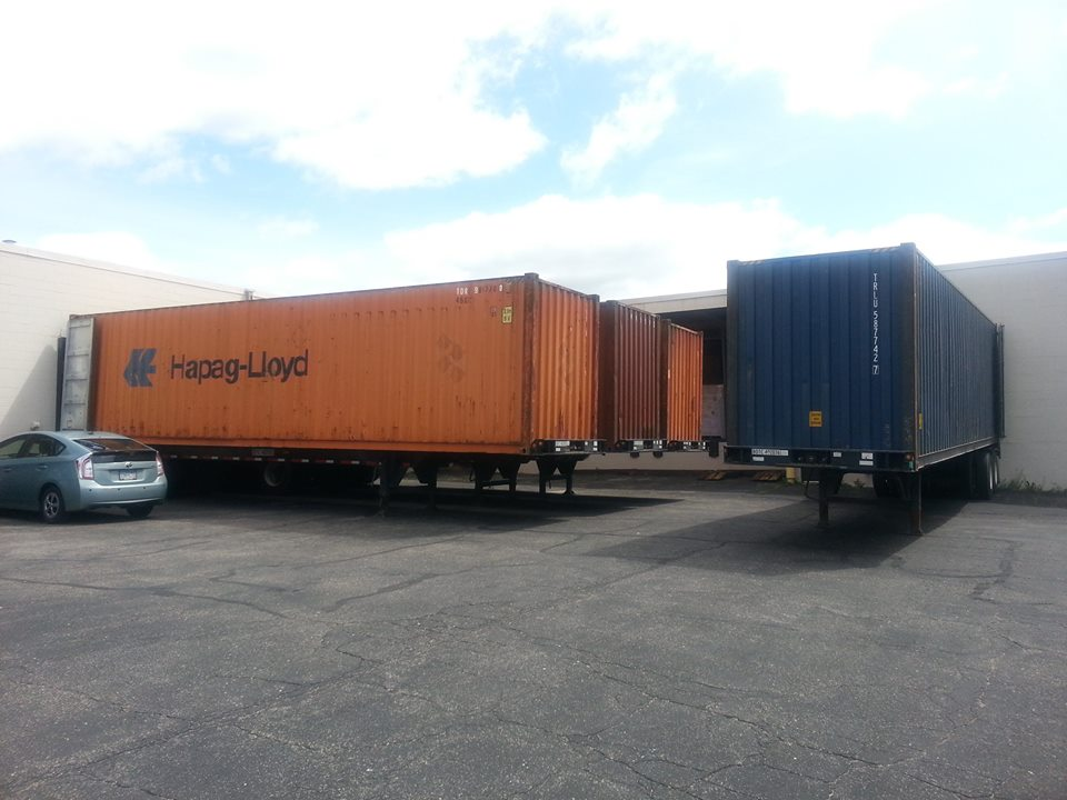 Containers at the Mano a Mano warehouse, June 2016.