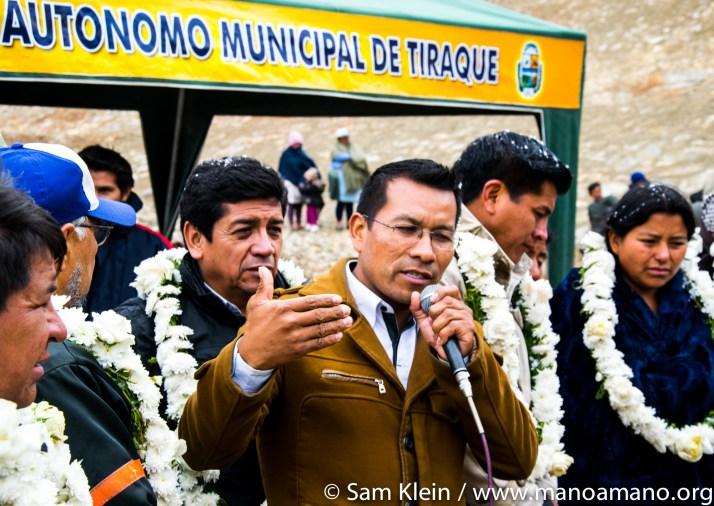 Tiraque's mayor speaks before the water starts to flow.