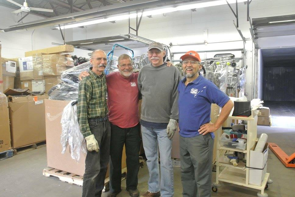 From left to right: Ray, Mark, and Bob, 3 of Mano a Mano's most dedicated volunteers, with our co-founder Segundo Velasquez, at the Mano a Mano warehouse over the weekend, working on loading 4 containers with more than 85,000 pounds of supplies in June 2016.
