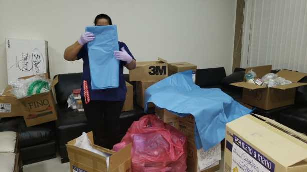 Organizing PPE supplies for distribution, April 9, 2020