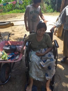 Pascuala sitting in her wheelchair for the first time.