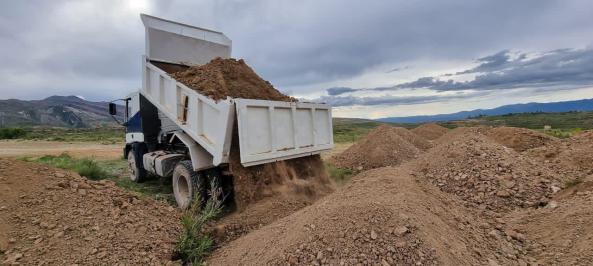 Transporting fill material. Building roadbed