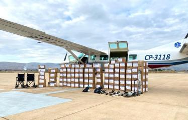 After loading everything onto the plane, we have to unload everything for inspection by airport officials before being approved for takeoff for this distribution of supplies in April.