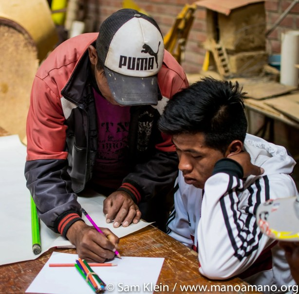 Leandro, who maintains the CEA, works on planning a greenhouse with a farmer.