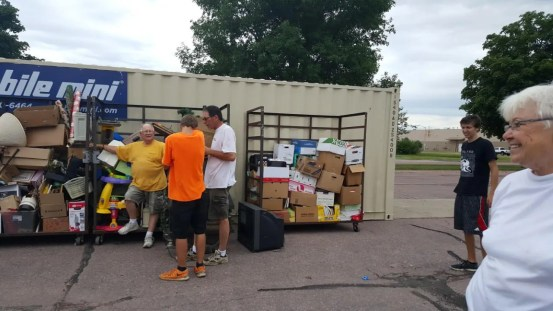 Collecting supplies to sell in support of Mano a Mano, Summer 2016