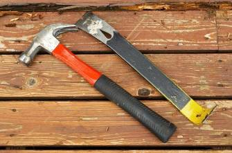 remove a hardwood floor with a claw hammer and pry bar