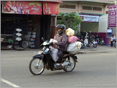 Man with bags on motor bike