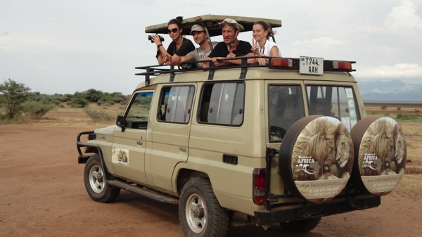 Open air roofless Toyota Landcruiser -- Safari with Shadows of Africa