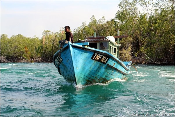 Young boy on squid jigging boat in Kuala Terengganu Malaysia