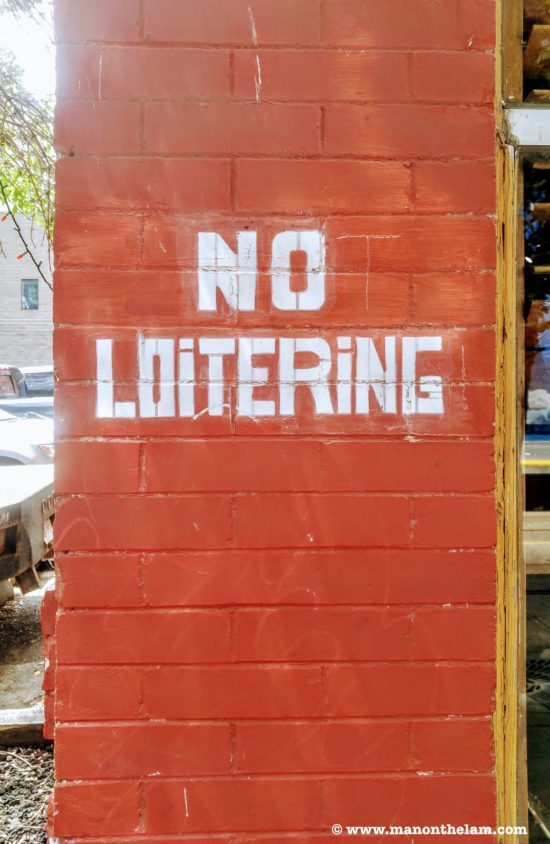 Not loitering sign street art graffiti brick wall escape room clues