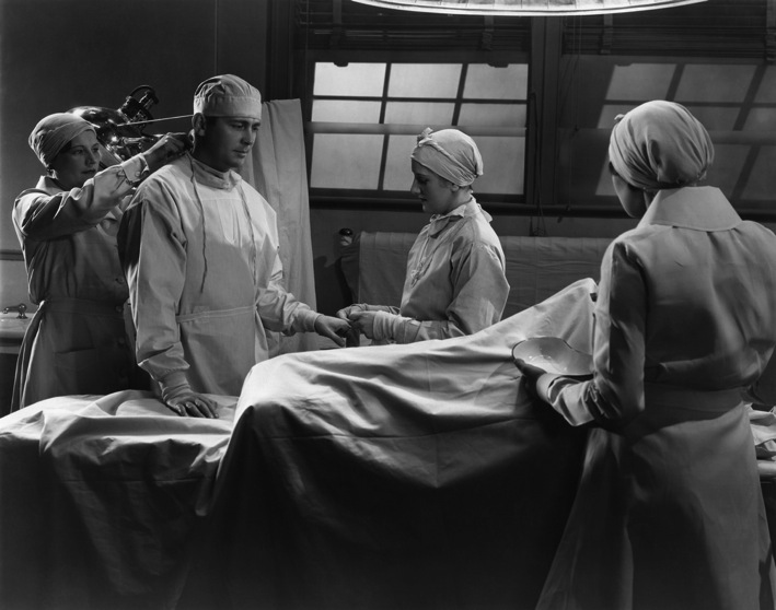 Doctor preparing for surgery Getting a testicular ultrasound in Oman vintage black and white