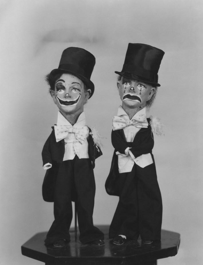 vintage happy and sad clown figures