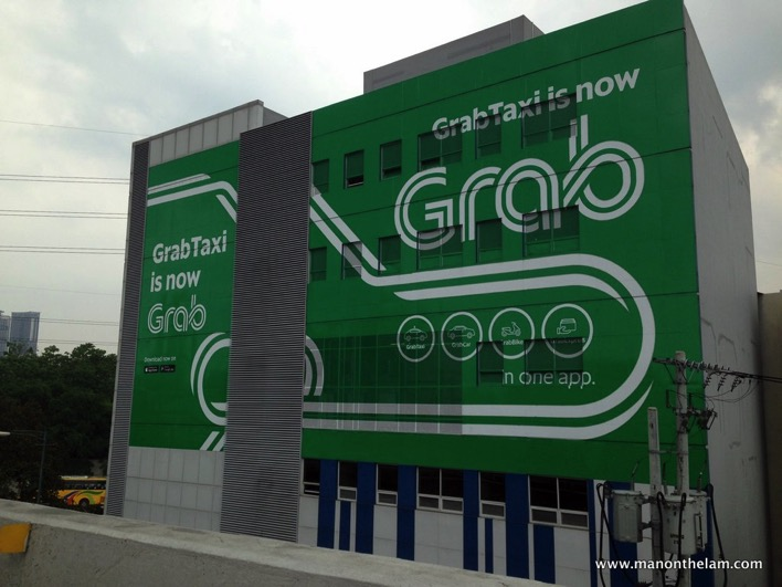 GrabTaxi is now Grab painted building Manila Philippines