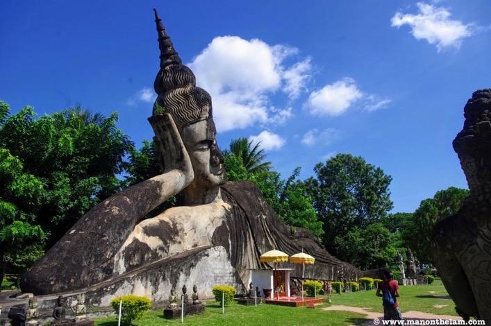 Giant stone reclining Buddha statue Buddha Park Vientiane Laos
