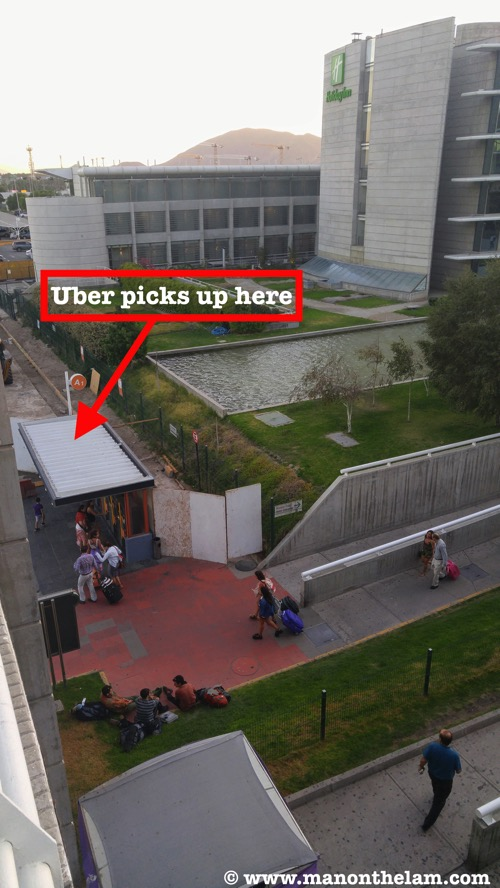 Uber Santiago pickup location Santiago Chile airport parking lot near Holiday Inn