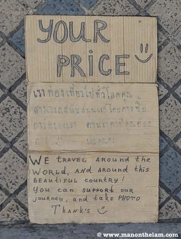 Your Price -- we travel around the world and around this beautiful country. Begpacker sign bangkok thailand -- 20170613_161811.jpg