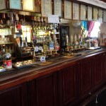 The bar of the Manor Arms. Well stocked and ready to serve!