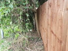 Replacement of a boundary fence( not straightforward as it's on a large hill before 8