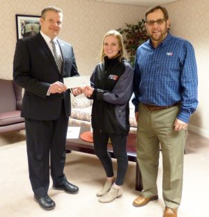 (L-R) MU President Scott Barton accepts a check for the PSECU Scholarship Fund from PSECU student intern Emily Tracy and PSECU e-Center Manager David Sikorski.