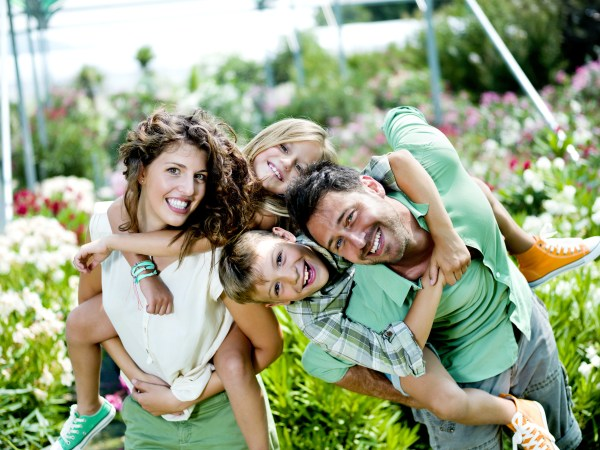 family having fun in a greenhouse