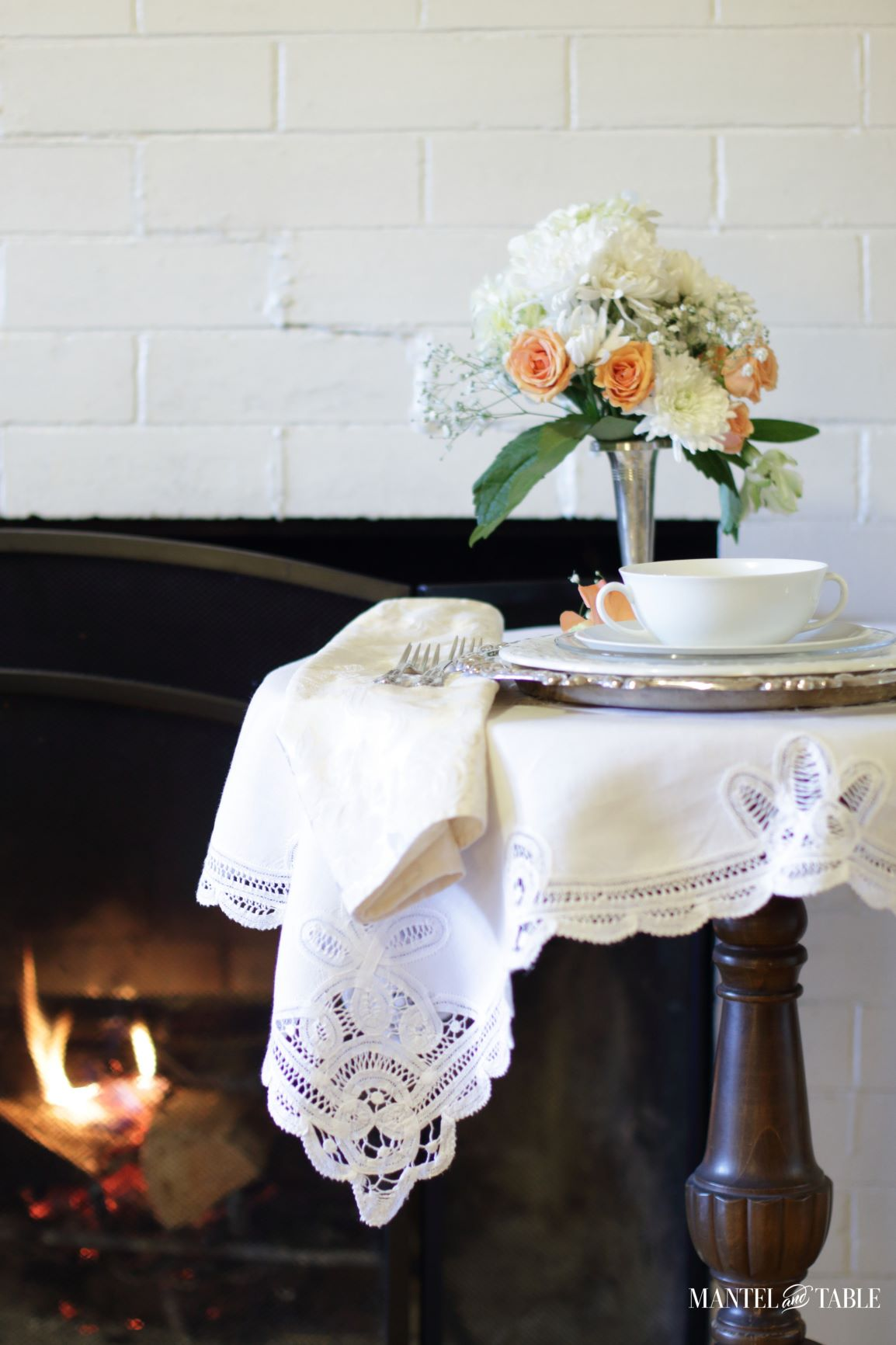 Table Setting for One ~ partial tabletop view with fire