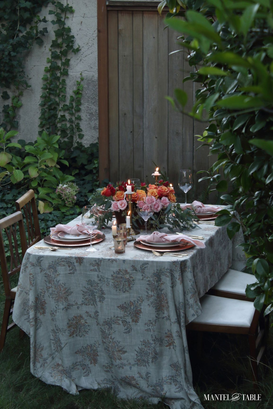 Pink and orange tablescape outside in the yard