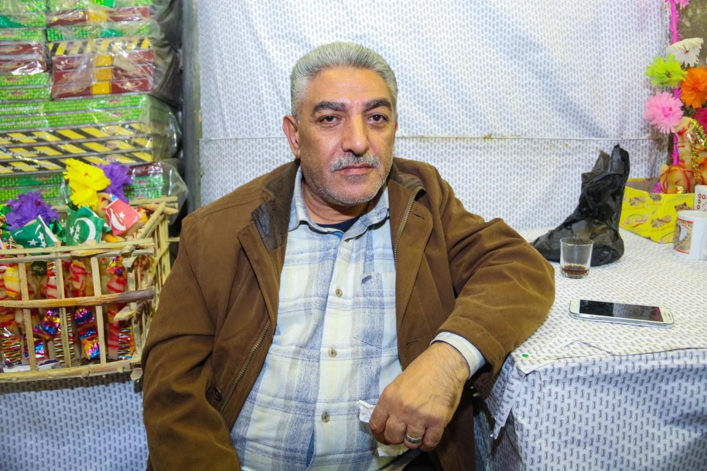 الحاج حسن الزغاط أحد أقدم تجار بيع حلوى المولد بشارع باب البحر