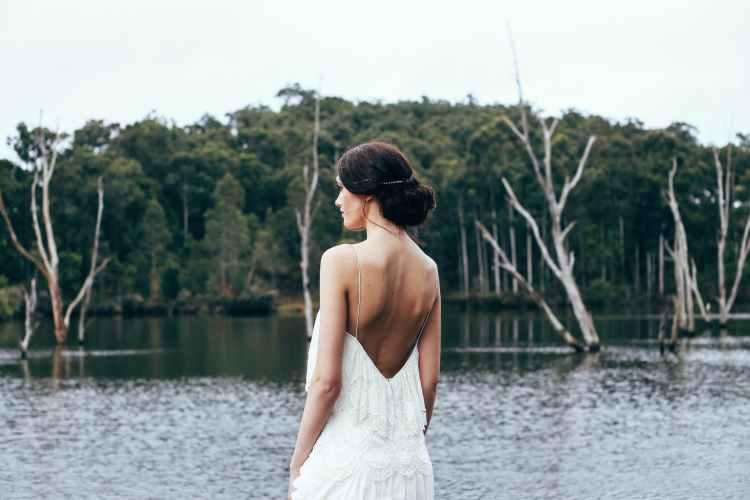 anonymous elegant bride standing near lake منتوف MANTOUF