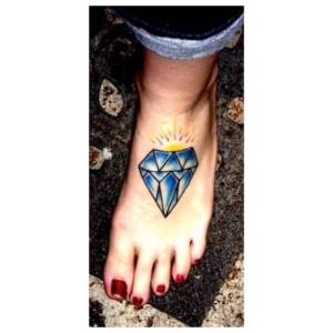 Foot tattoo by Jen