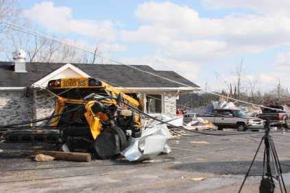 During the storm, one school bus was lifted into the air and thrown into a small maintenance repair shop.