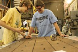 Michael Chandler (11) and Michael Rivera (11) work on what will be a door used as a prop for Macbeth.