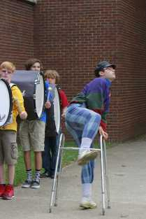 Nathaniel Smith (12) dances infront of the band members as the seniors gathered outside the large gym. Photo by Lisa Pham