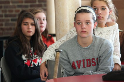 Clare Hachten(10) listens to Wooldridge speak on their behavior these past couple weeks.