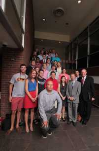 The Manual and UofL students stand together for a group photo with Paul prior to his speech.