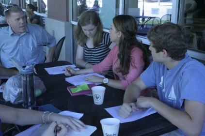 Emily McConville (12) and Emily Meffert (12) discuss ideas for IdeaFest Manual