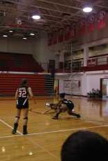 Taylor Little and Emily Porta collide in an effort to pass the ball.