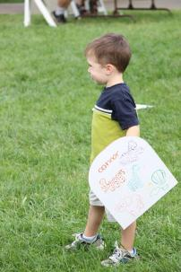 """Children play with their cardboard shields while screaming """"FOR IRELAND!"""""""
