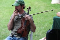 Musician displays many instruments and plays a couple songs at Irish Fest.