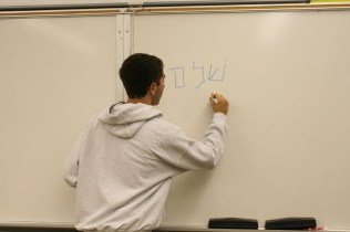 Shpilberg writes in Hebrew on the board. Photo By: Alexis Weaver