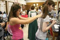 Hayley Watson (9) helps Elizabeth Ward (9) with her costume. Photo by Julia Nguyen.