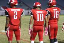 Miles Thompson (12) and Dishan Romine (12) prepare for the coin toss against the Rocks