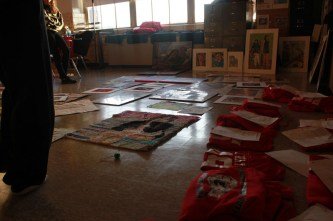 The seniors laid out all of their artwork to visualize which pieces will go into the show and where they will be placed.