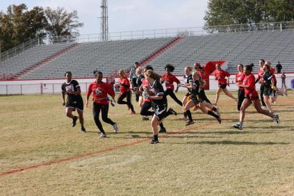 Kristin Mudd (12) intercepts the ball and tries to run through Mackinley Poole (11).
