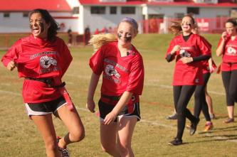 Priyda Matadar (11) and Lauren Fiscus (11) get pumped for the second half.