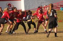 Bailey Hawkins (11), Emily Wilbar (11), and Alex Luckertt (11) go for Sadaf Khodaparast's (12) flag.