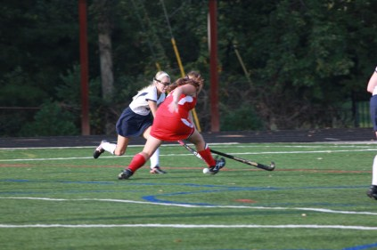 Clare Grady (12) fights with her opponent to get the ball away from the Valkyries.