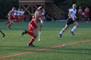 Hannah Kingsbury (12) runs towards Sacred Heart's goal with the ball.