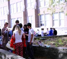 A group of students enjoy the sun and lunch while in their sleepwear attire. Photo by Jack Steele Mattingly