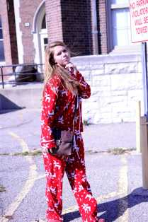 Kinsey Ball (11) strikes a pose at lunch sporting her Christmas-themed pajamas. Photo by: Jack Steele Mattingly